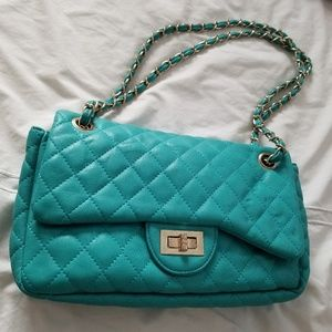 Teal quilted handbag with braid chain